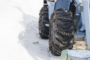 DeLorenzo Landscaping Schenectady NY - Tractor rides and cleans the road from the snow to the blizzard